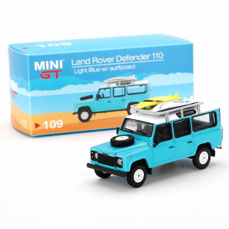 MINI GT Land Rover Defender 110 - Light Blue w/Surfboard RHD